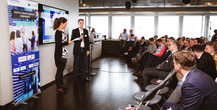 Birte Gall, Managing Director of the Berlin School of Digital Business, and Gregor Puchalla, Managing Director of FinTechCube, welcome those attending Digital Finance Berlin.